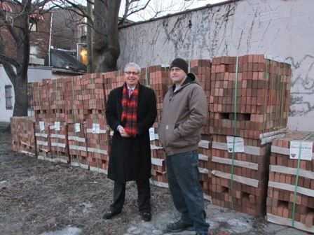 David Newton, vice president of Palmer Square Management of Princeton, left, and Pat Brogan, Weekend Construction supervisor for Habitat for Humanity of Trenton, oversee the delivery of bricks.